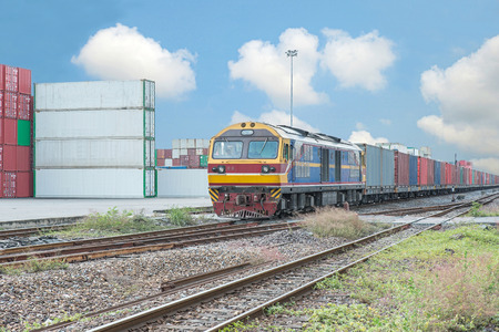 42179485 - cargo train platform with freight train container at depot